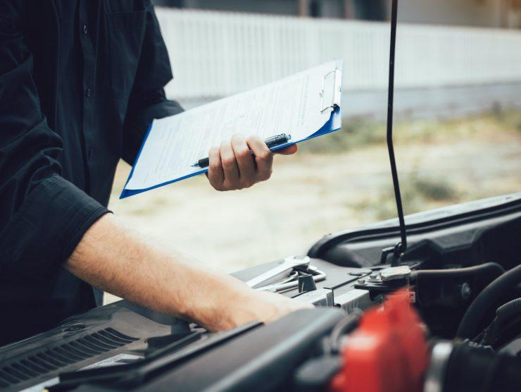 Car mechanic repairing vehicle engine working job.
