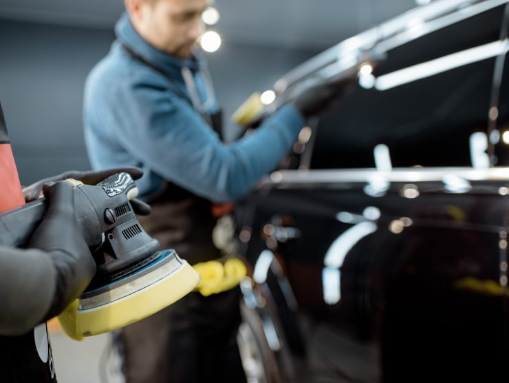 Professional car body polishing at the service